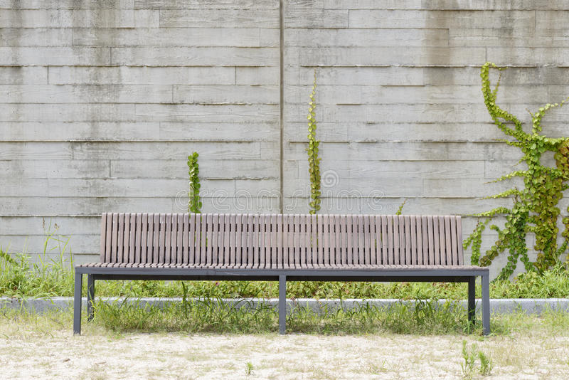 Long bench in front of a white wall stock photo