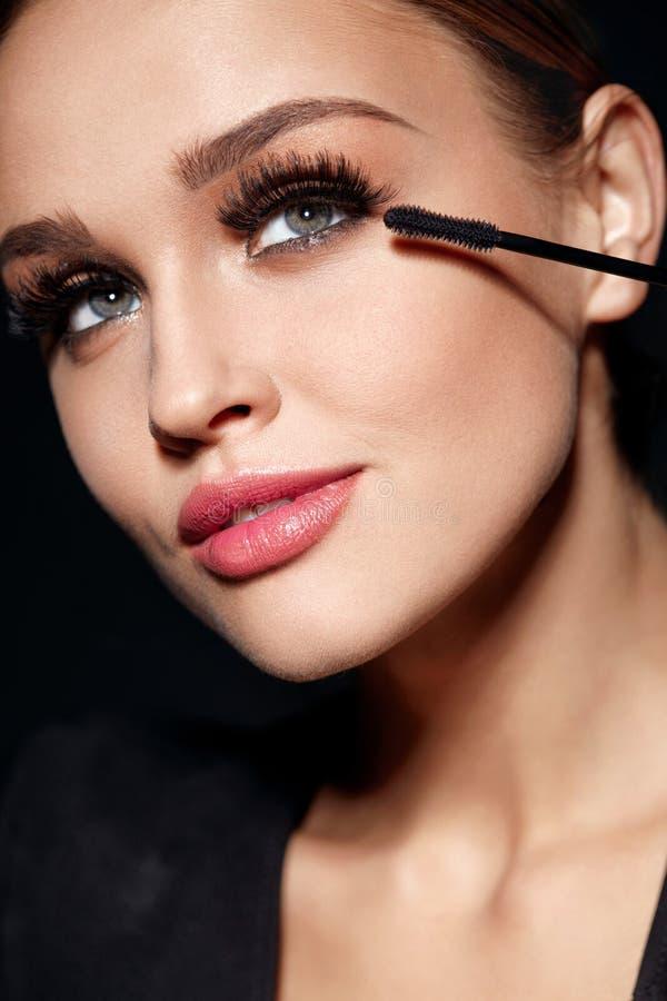 Long Black Eyelashes. Woman With Makeup Applying Cosmetics. Long Black Eyelashes. Closeup Of Beautiful Girl With Mascara Brush Near Face. Glamorous Woman With royalty free stock images
