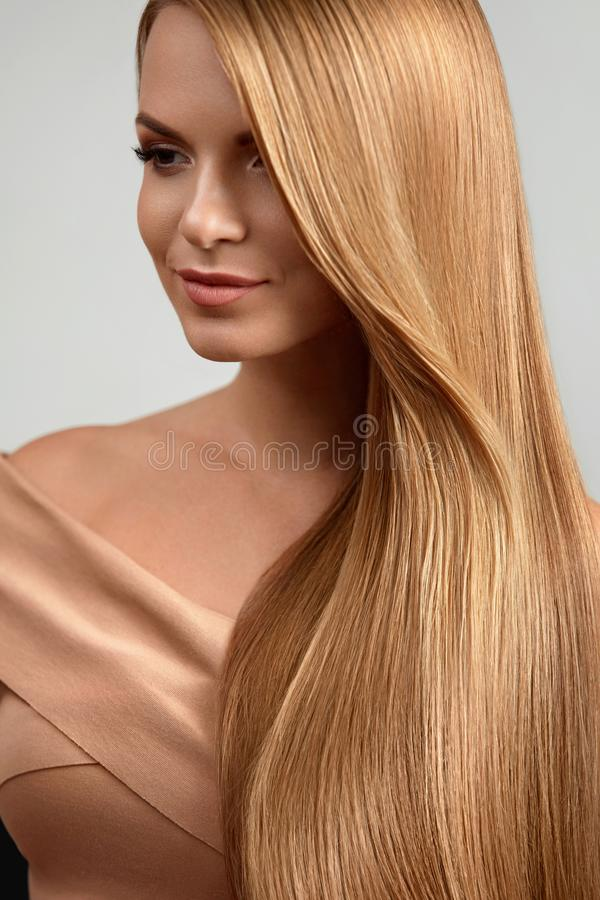 Long Blonde Hair. Beautiful Woman With Healthy Straight Hair. Girl With Natural Glossy Blond Hair. High Resolution royalty free stock photo