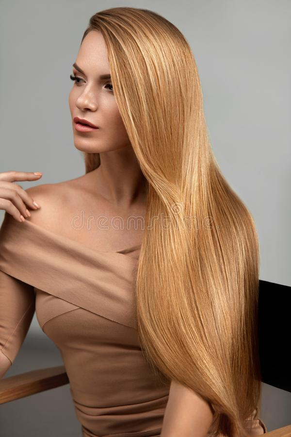 Long Blonde Hair. Beautiful Woman With Healthy Straight Hair. Girl With Natural Glossy Blond Hair. High Resolution royalty free stock images