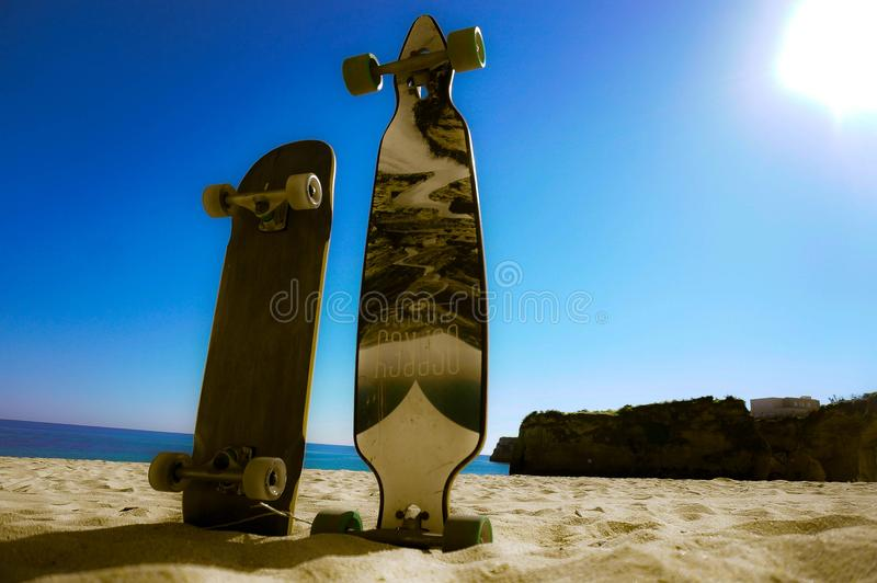 Long board adventures. Today we were in Lagos and found a beautiful beaches where we propped up the boards for this picture royalty free stock photos