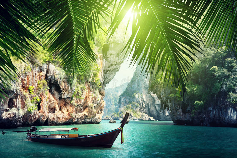Long boat and rocks on beach in Krabi. Thailand stock photography