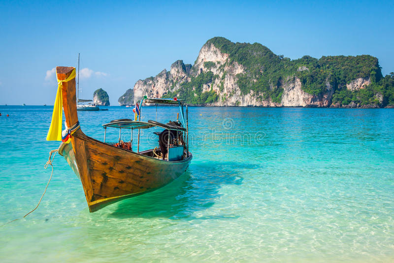 Long boat and tropical beach, Andaman Sea, Phi Phi Islands, Thaila. Nd Asia royalty free stock image