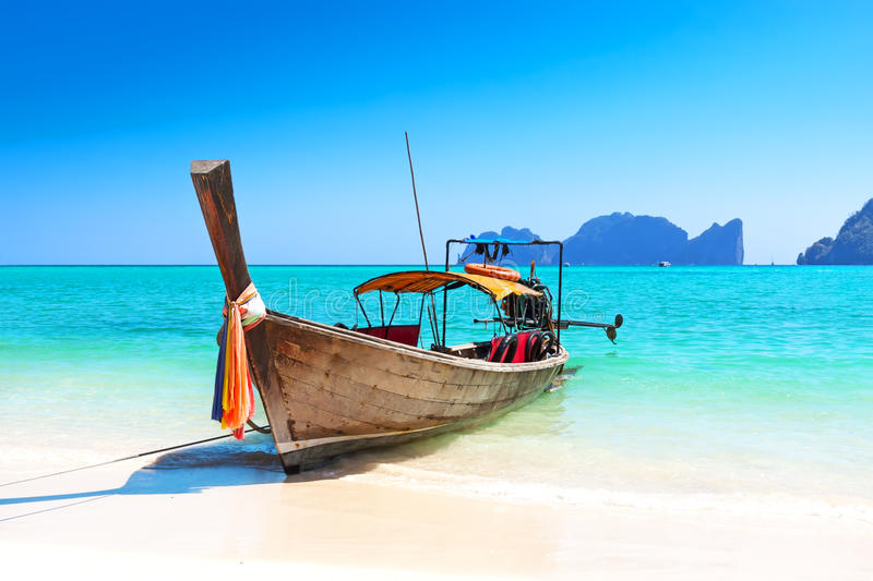 Long boat and tropical beach stock photos