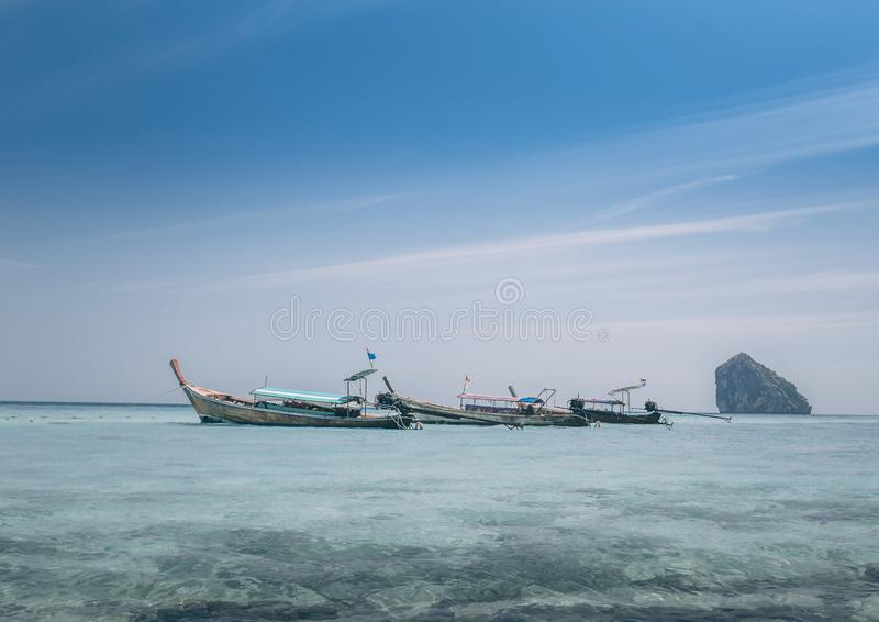 Long boats sailing at sea stock image