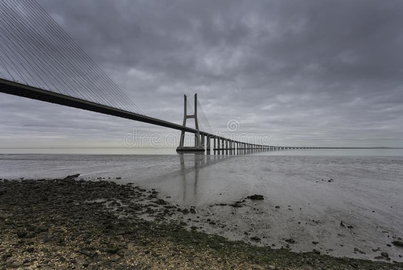 Long bridge over tagus river in Lisbon at dawn royalty free stock photos