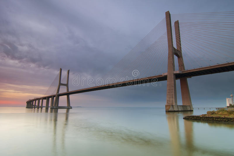 Long bridge over tagus river in Lisbon at dawn royalty free stock images