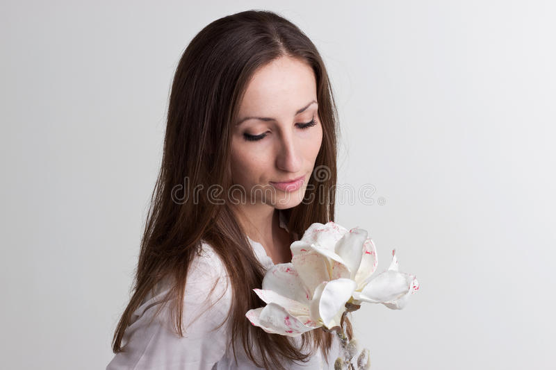 Long Brown Hair Woman with Subtle Face and White Flower royalty free stock photo