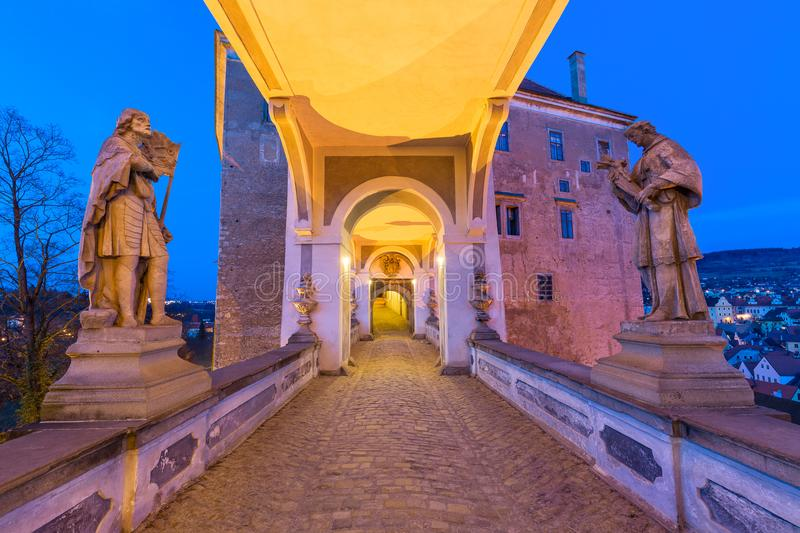 The long corridor above the Cloak Bridge with statues, located in Cesky Krumlov castle, South Bohemia in Czech Republic. Sunset bl stock photo