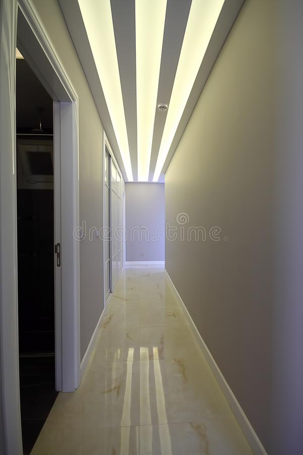A long corridor with doors at the sides and a light at the end of the corridor royalty free stock photos
