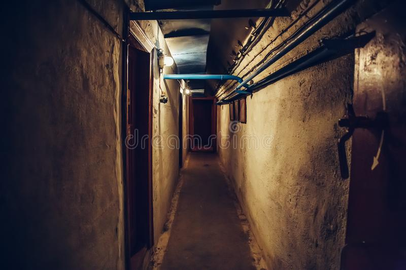 Long corridor or illuminated tunnel in bomb shelter, underground military bunker of cold war, perspective. Toned stock images