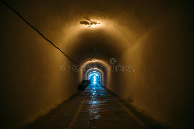 Long corridor or illuminated tunnel in bomb shelter, underground military bunker of cold war, perspective stock photo