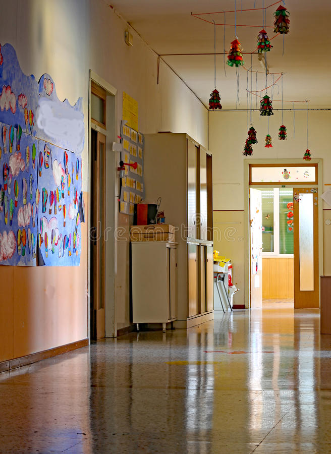 Long corridor of the kindergarten with drawings stock photo