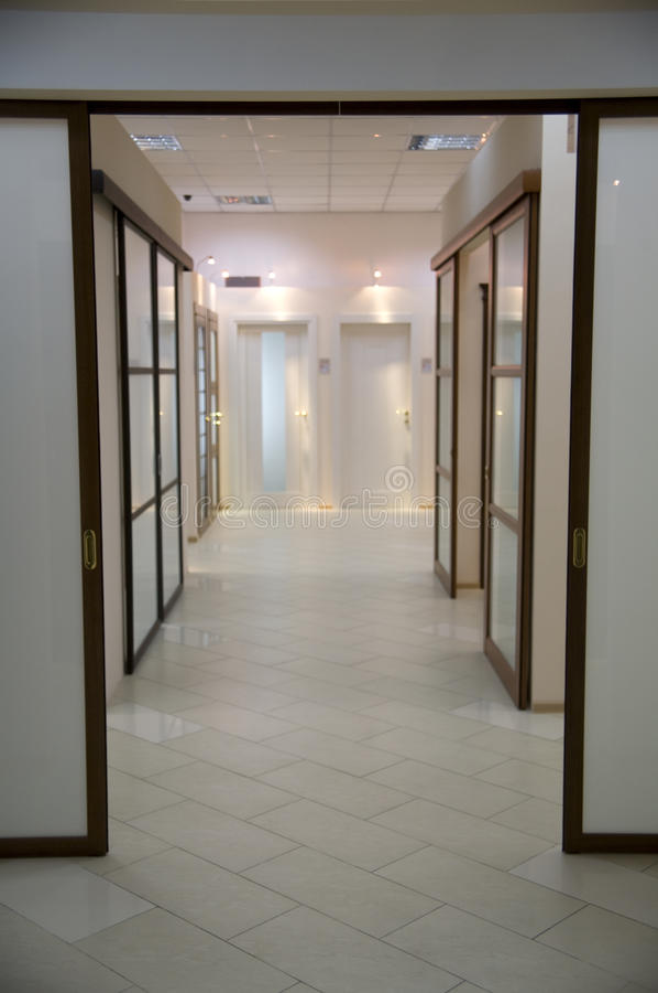 Long corridor and many doors royalty free stock photo