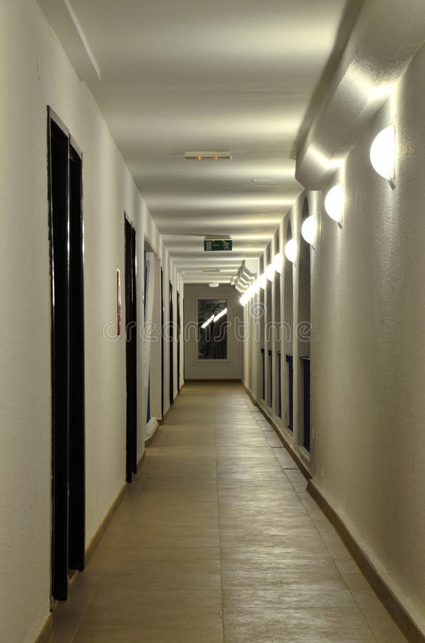 The Long Corridor With A Succession Of Wall Lamps In Its