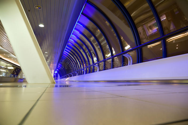 Long corridor with windows in modern building. Long corridor with big windows in modern building at night, foreshortening from below, wide angle royalty free stock image