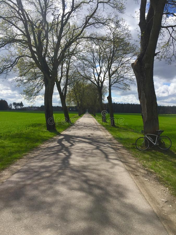 Long country road for cycling with bike royalty free stock photography