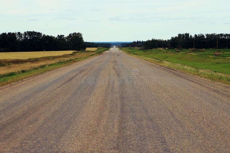 Long country road to nowhere stock photography