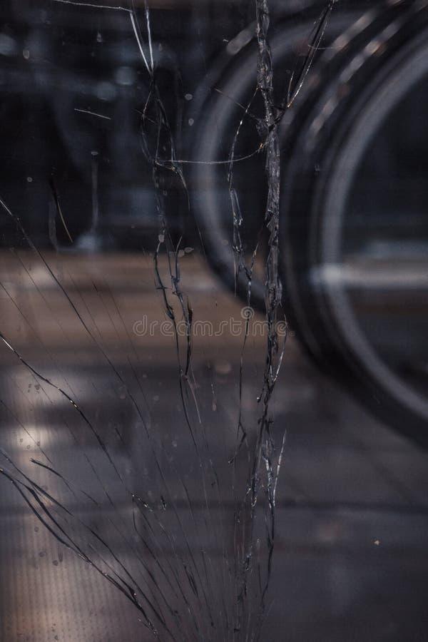 Long cracks on broken glass close up. texture, background, wallpaper stock photos