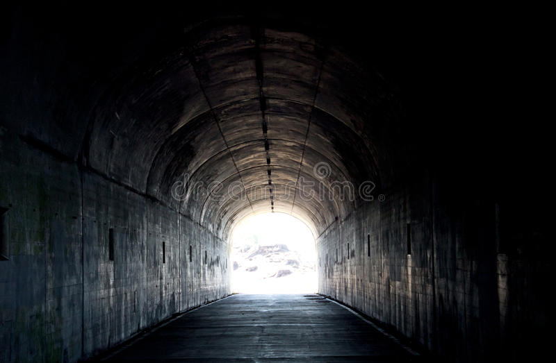 Long dark tunnel with light at the end stock photo image for Silverleaf com