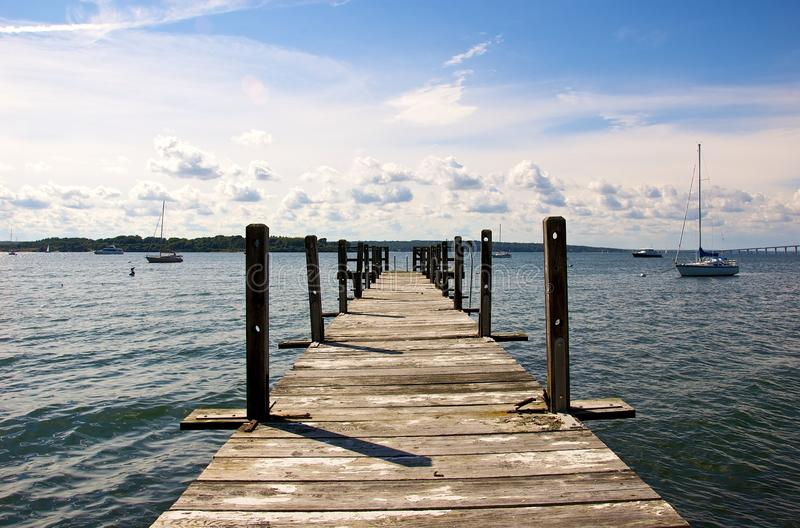 Long Dock. Dock extending into the Narragansett Bay on a sunny day royalty free stock photos