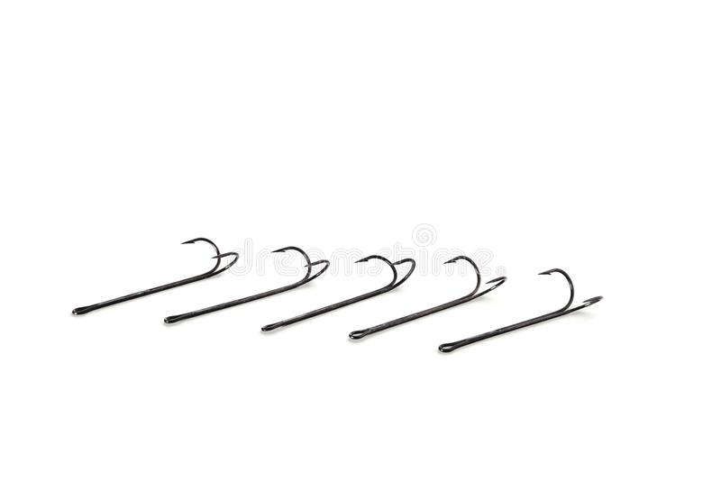 Long double hooks for fishing white background close-up. Copy space stock photography