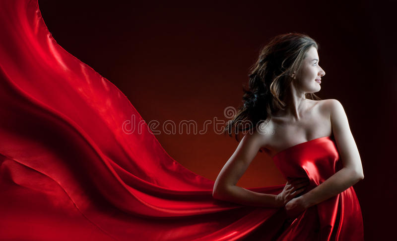 Long dress. Beautiful young woman in red long dress royalty free stock photo