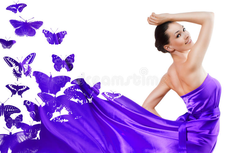 Long dress. Beautiful young woman in purple long dress royalty free stock photos