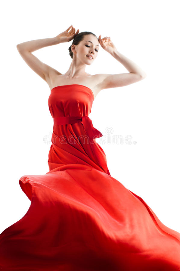 Long dress. Beautiful young woman in red long dress royalty free stock photos