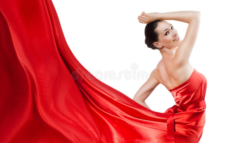 Long dress. Beautiful young woman in red long dress stock photography