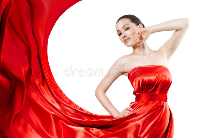Long dress. Beautiful young woman in red long dress royalty free stock image
