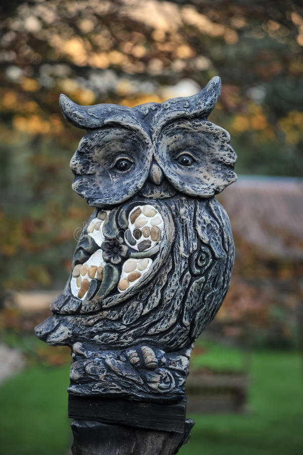 Long-eared Owl stone sculpture stock image