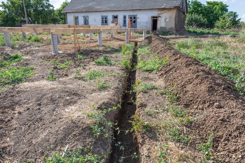 Long earthen trench dug to lay pipe. royalty free stock photography