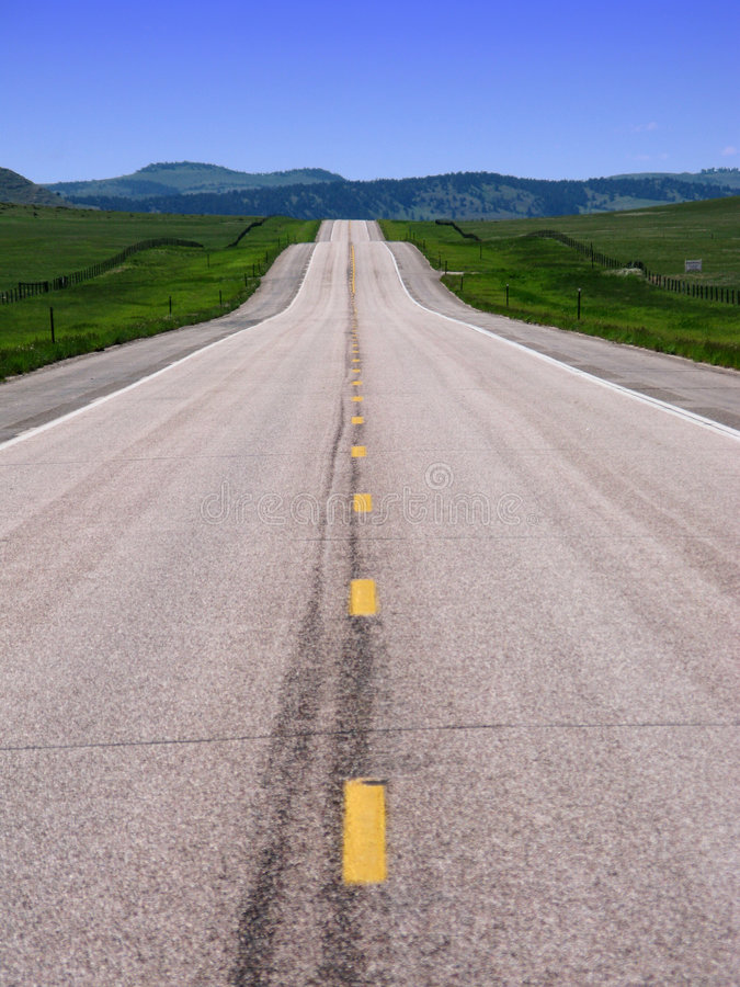 Long Empty American West Country Road and Hills royalty free stock photo