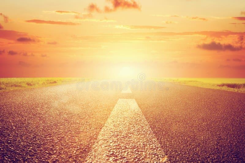 Long empty asphalt road towards sunset sun. royalty free stock photo