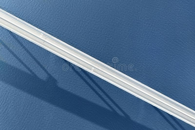 Long empty  bridge over large river or sea aerial top view royalty free stock images
