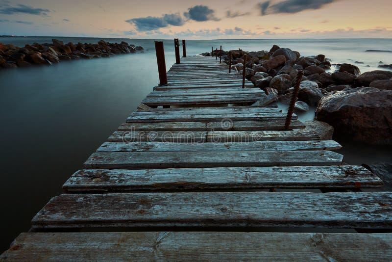 Long eposure ocean wooden pier nigt time stock photography