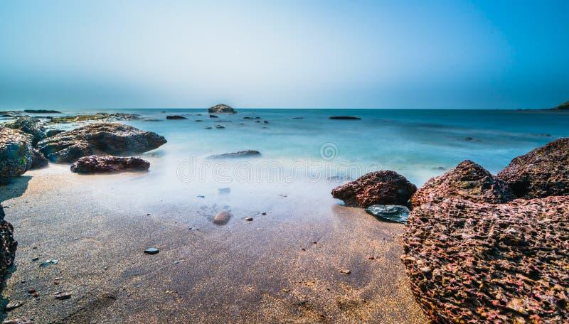 Long exposure at beach. Long exposure shot of tranquil waves at Anjuna Beach, Goa in summer stock photography