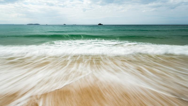 Long exposure of a beach near Saint-Malo on a cloudy day in summer. Long exposure of a beach near Saint-Malo Brittany, France on a cloudy day in summer stock images