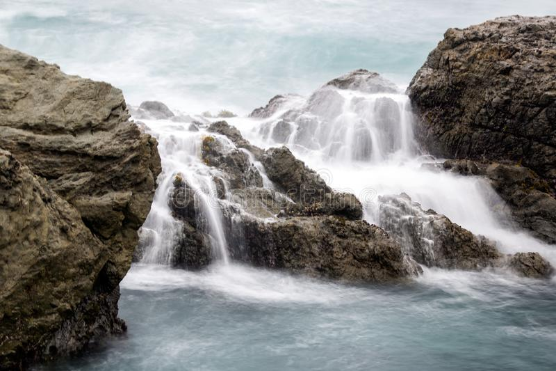 Long exposure of beach rocks. In the fog stock images