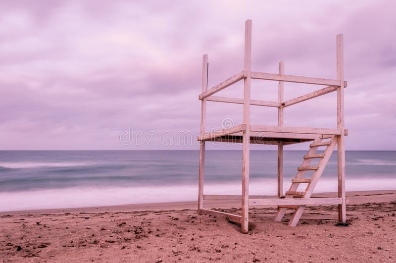 Long exposure of beach in winter at sunset. Long exposure of beach in a cloudy sunset of winter royalty free stock photo