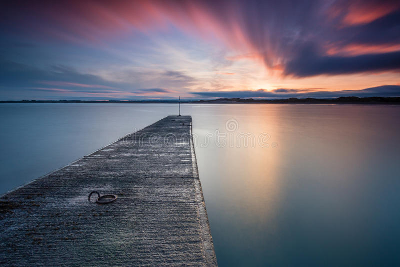 Long Exposure at Beadnell Harbour and Bay. Beadnell is a village on the Northumberland coastline, with a small fishing harbour set into Beadnell Bay. Disused stock photos