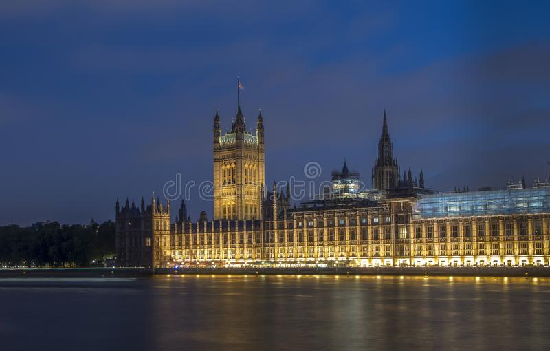 Long exposure blue hour shot of Westminster Palace London. With beautiful reflections in River Thames stock image