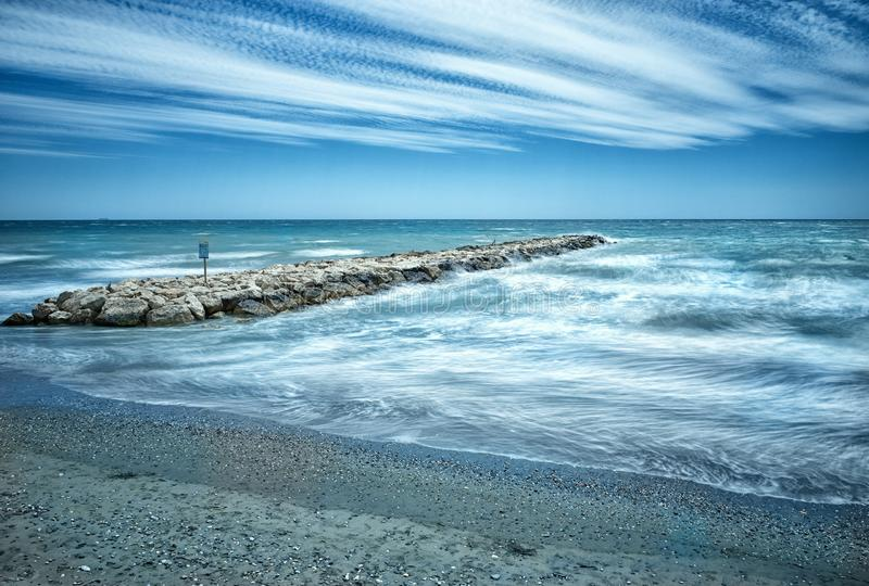 Long exposure, waves against breakwater at Torrox Costa, Southern Spain. stock photos