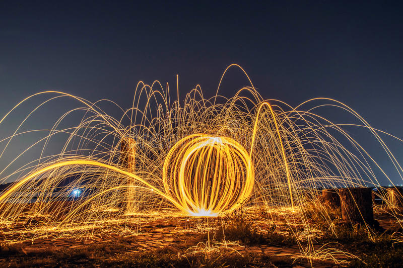 Long exposure burning and spinning of steel woolon stock image
