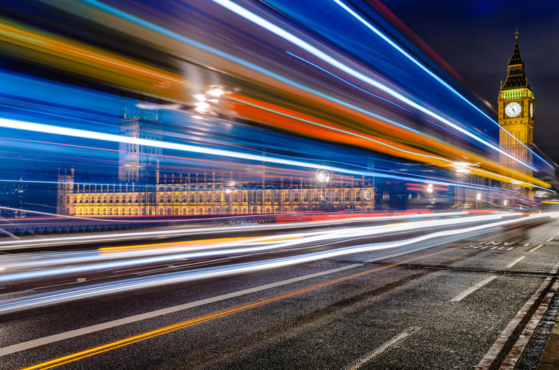 Long exposure of a bus in front of Big Ben, London stock images