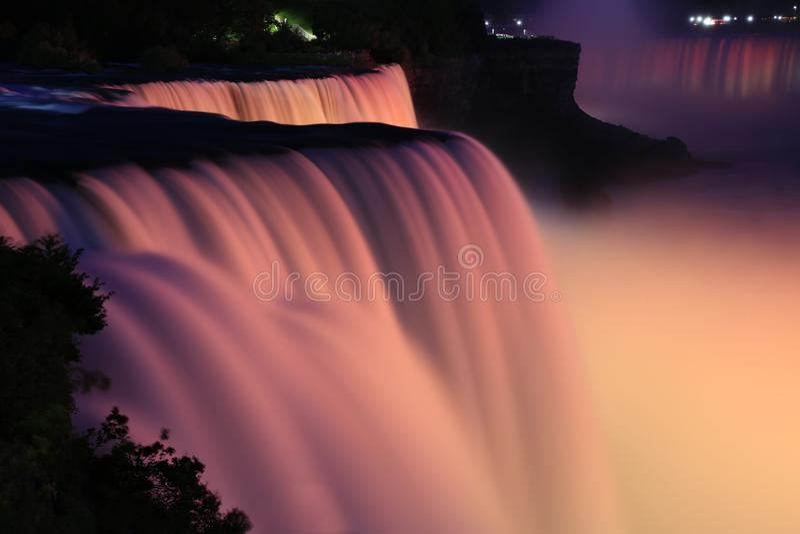 Long-exposure close-up of Niagara Falls illuminated at night royalty free stock photo