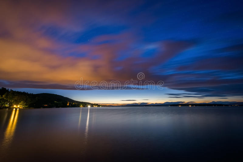 Long exposure of clouds moving over Lake Winnipesaukee at night, at Ellacoya State Park, in Laconia, New Hampshire. stock photography