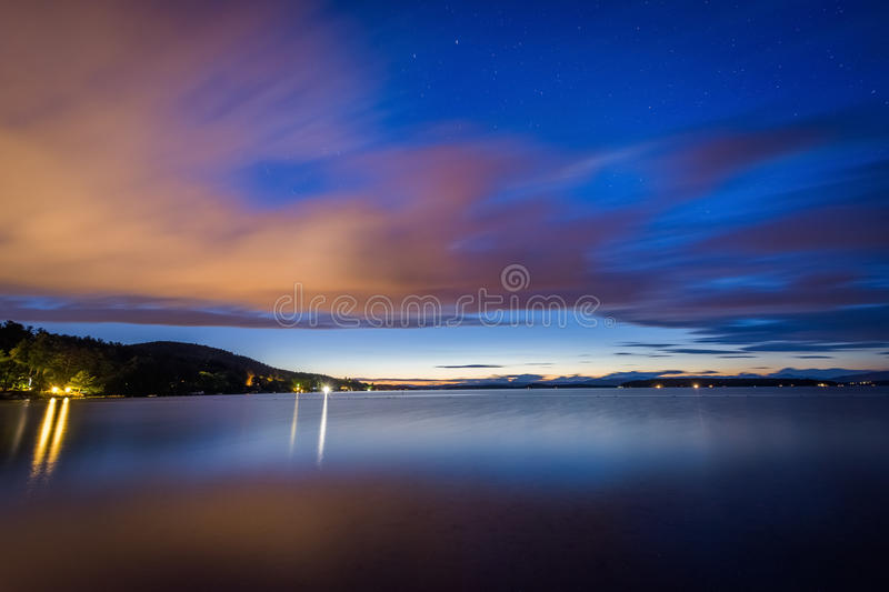 Long exposure of clouds moving over Lake Winnipesaukee at night, at Ellacoya State Park, in Laconia, New Hampshire. royalty free stock photo