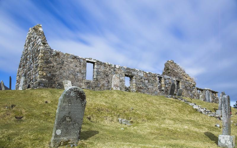 Long exposure of clouds over a ruined chapel on a sunny day stock photos